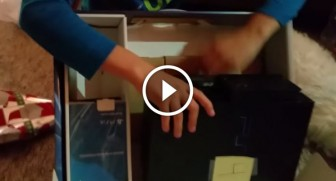 Big brother Christmas pranks his little brother with a PS2 in a PS4 box
