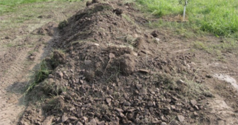 Officers Hear Whimpering Coming From This Pile Of Dirt. When They Get Closer…