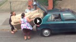 These People Tried To Fit a Sofa In a Tiny Car. This Is Every Bit As Stupid As It Looks